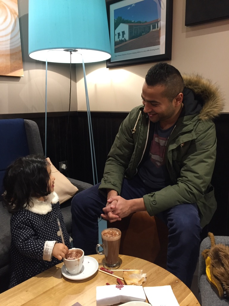 Daddy and his little girl  bonding over a hot chocolate