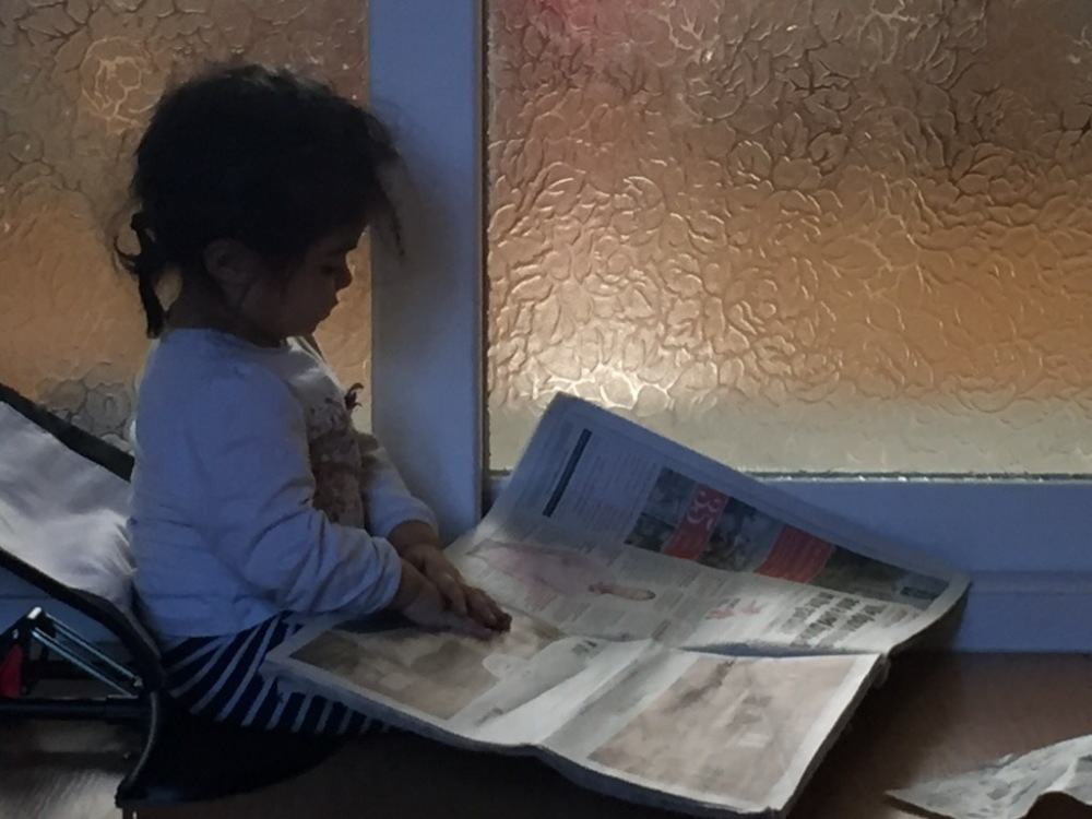 Toddler reading the newspaper, what could go wrong?